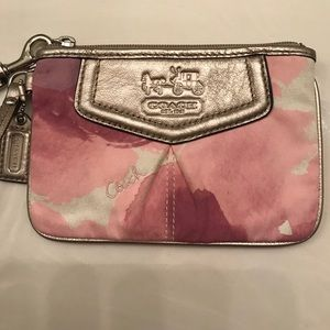 Pink flowered Coach wristlet